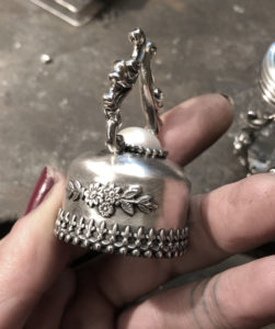 silver poison perfume bottle